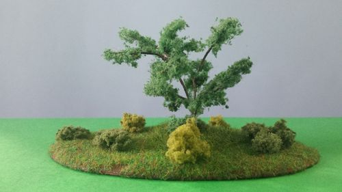 finished wooden base with one tree